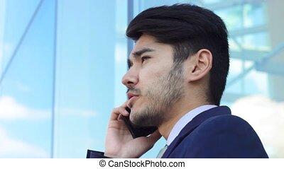 Talking businessman. Closeup portrait of asian man. -...