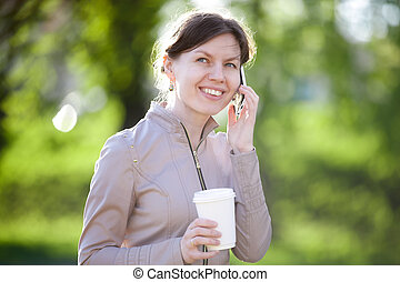 Talking on mobile phone in park