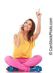 talking on phone and pointing up