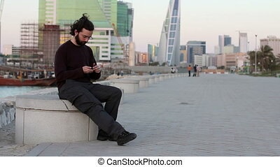 talking on phone at park
