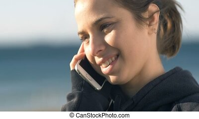 Talking on phone attractive young adult model woman girl portrait