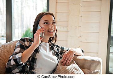 Talking on phone in living room