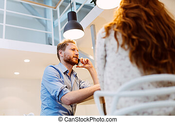 Talking on phone while dating woman