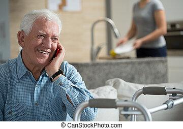 Talking the phone - Elderly sick man talking the mobile...