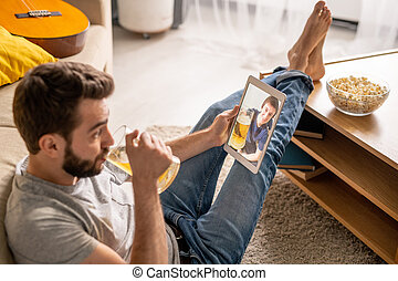 Talking to friend online while drinking beer