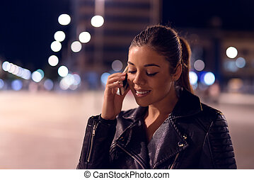 Talking to someone special - Young smiling woman talking on ...