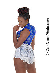 Tall African woman standing from back in shorts