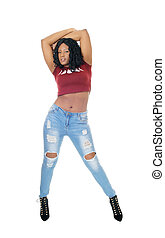 Tall African woman standing in jeans.