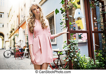 Tall and pretty young model walking in old town - Tall and...