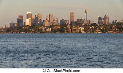 Tall buildings and ocean - A wide shot of the ocean with...