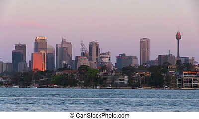 Tall buildings and sea pier - A wide shot of buildings and...