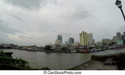 Tall buildings built along huge Pasig River banks
