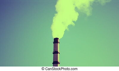 Tall chimney with coming smoke background blue sky