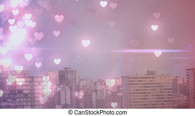 Tall city buildings filled with hearts
