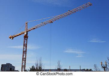 Tall crane at work.