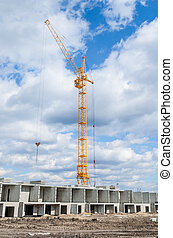 Tall cranes and building of houses