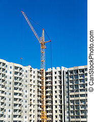 Tall cranes and multistorey housing under construction