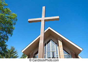 Tall Cross with Modern Church in Background - Wide angle...