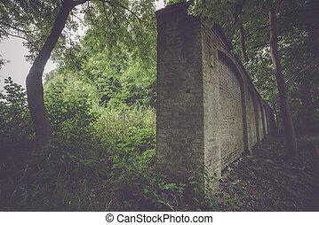 Tall dark brick wall