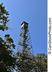 Tall fire tower reaches above treetops - A tall fire tower ...