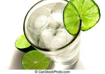 Tall glass of ice water with a slice of lime