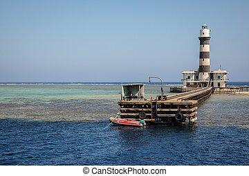 Tall lighthouse on the sea