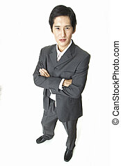 Tall - A distorted view of an asian businessman