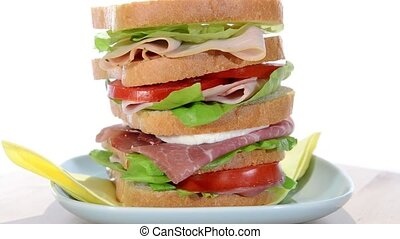 sandwich - tall sandwich with ham, chicken, cheese and ...