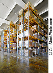 Tall shelves and racks in distribution warehouse