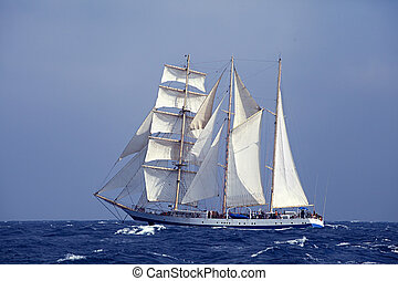 Tall ship in the sea - Barquentine with white sails in the...