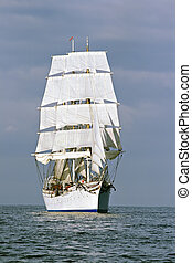Tall ship - Ship with white sails in the calm sea