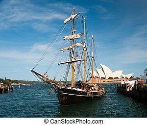 Tall masted vintage sailing vessel in Sydney Harbor.