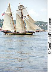 Tall masted schooner under full sail