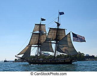tall ship with american flag - tall ship sailing flying an...