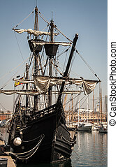 Tall Ship - Wooden tail ship in a harbour in Barcelona