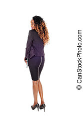 Tall slim woman standing from back.