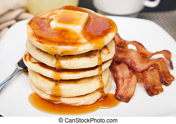 Tall stack of pancakes with bacon - A tall stack of pancakes...