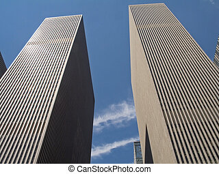 This is a shot of two very tall skyscrapers at Rockefeller Center in New York City.