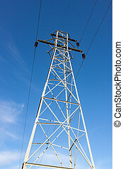 Tall Transmission Tower Against Blue Sky