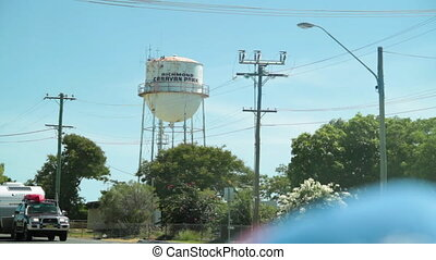 Tall water tank shot - A long shot of a tall water tank