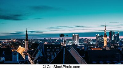 Tallinn, Estonia, Europe. Time Lapse Time-lapse Of Cityscape. Transition From Night To Morning Sunrise. Old Town And Modern City. Famous Landmarks. UNESCO. Pan Panorama