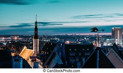 Tallinn, Estonia, Europe. Time Lapse Time-lapse Of Cityscape. Transition From Night To Morning Sunrise. Old Town And Modern City. Famous Landmarks. UNESCO. Zoom Out Pan Panorama