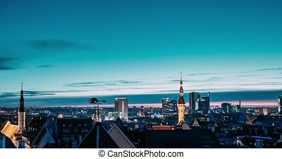Tallinn, Estonia, Europe. Time Lapse Time-lapse Of Cityscape. Transition From Night To Morning Sunrise. Old Town And Modern City. Famous Landmarks. UNESCO. Zoom In Tilt