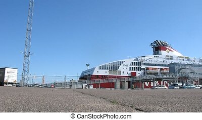 Vehicles board ferry ship