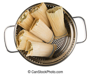 Tamales in steamer ready to be cooked