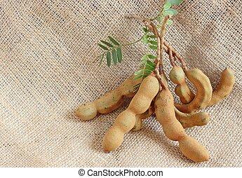 Tamarind fruit on natural sackcloth texture