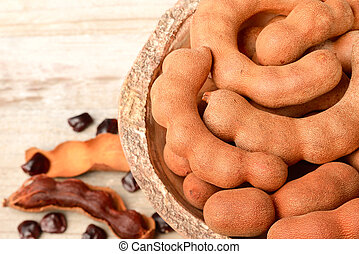 tamarind fruits on the wooden board