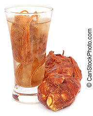 Tamarind juice in a glass over white background