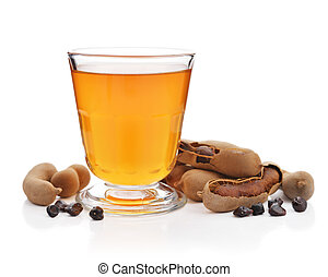 Tamarind juice with tamarind pods isolated on white background