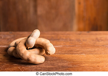 Tamarind - Sweet ripe tamarind on rustic wooden table with...